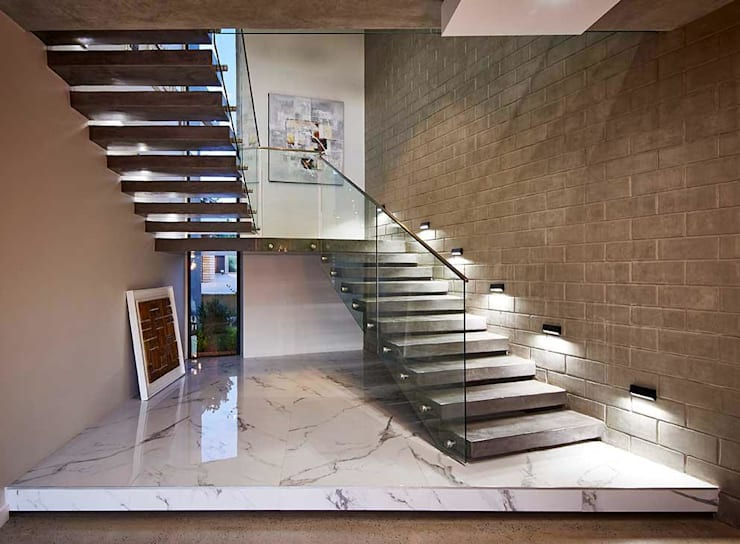 Main Staircase: industrial  by Simply By Design, Industrial Concrete