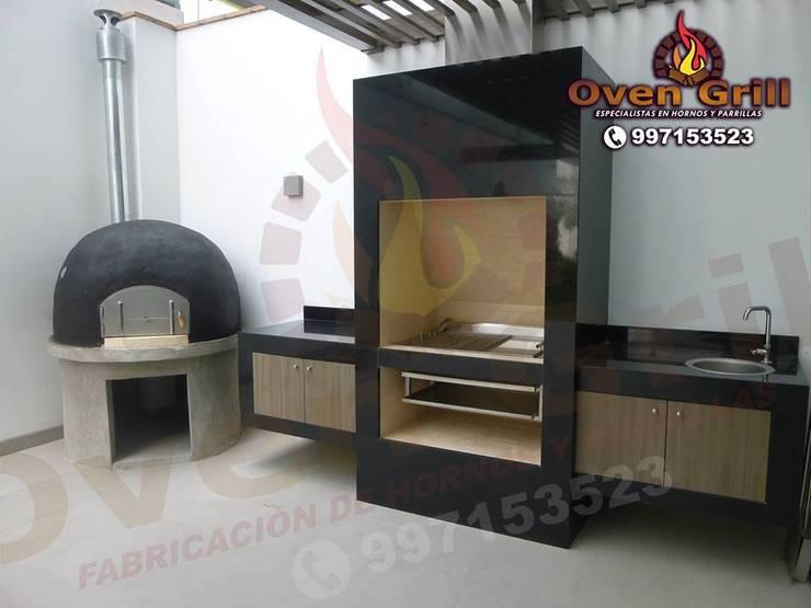 Parrilla en granito con Horno color Negro: Hogar de estilo  por Oven grill