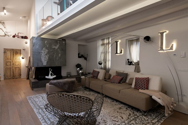 Living room by GIAN MARCO CANNAVICCI ARCHITETTO