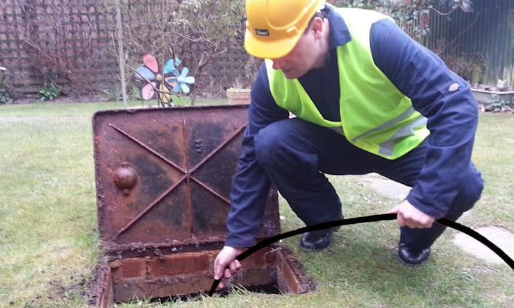 Opening Up A Drain That Was Blocked:  Front yard by Plumber George