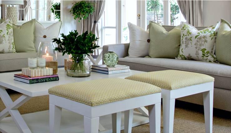 Pop of yellow :  Living room by Joseph Avnon Interiors