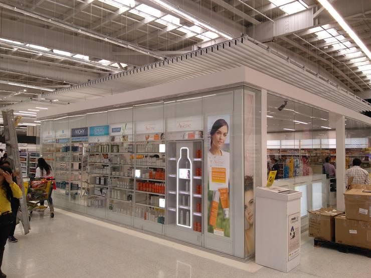 OTC ÉXITO WOW DEL COUNTRY -BOGOTÁ D.C [VITRINA & ESTRUCTURA METÁLICA]: Centros comerciales de estilo  por Arquitectura & Tecnología