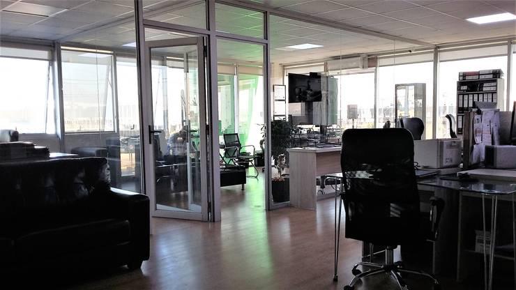 OFICINAS ALVEAL MUSICA- RENCA: Estudios y biblioteca de estilo  por AOG