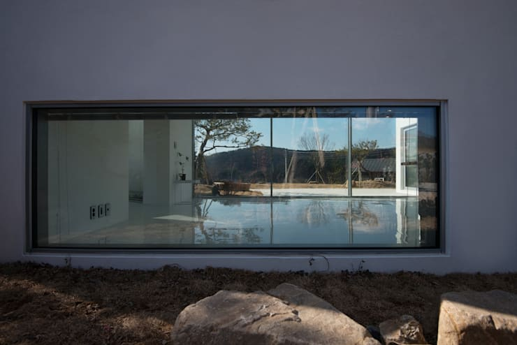 Meta House: ARCHIRIE의  주택,