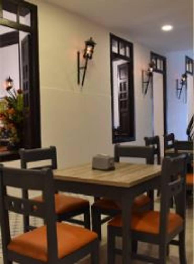RESTAURANTE TASTYZÓN: Comedor de estilo  por mutuo diseño interior