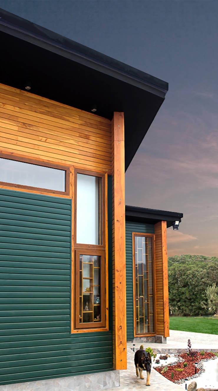 Fachada: Casas de estilo  por Intermedio Arquitectos