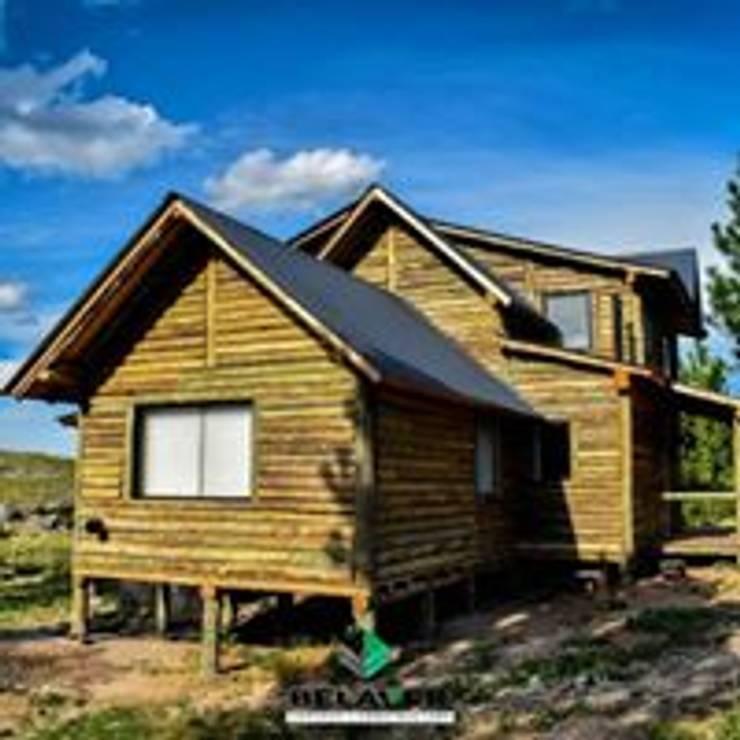 Construcciones de cabañas en tronco: Estadios de estilo  por Constructora Belaver,