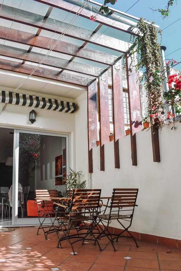 Reforma Casa NI: Jardines de estilo  por ERA - Estudio Rosarino de Arquitectura,