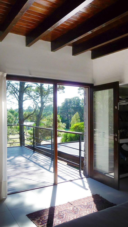 Casa Mar de las Pampas: Dormitorios de estilo  por CRF Arquitectos,