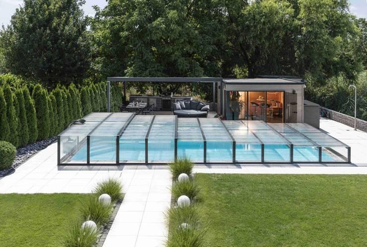 Privates Schwimmbad in den eigenen vier Wände:  Garten von Well Solutions GmbH