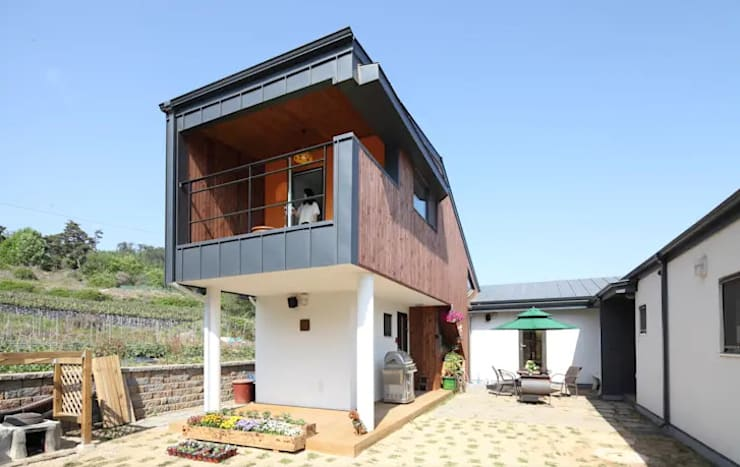 Mẫu nhà 2 tầng độc đáo phong cách Hàn Quốc:   by TNHH xây dựng và thiết kế nội thất AN PHÚ CONs 0911.120.739