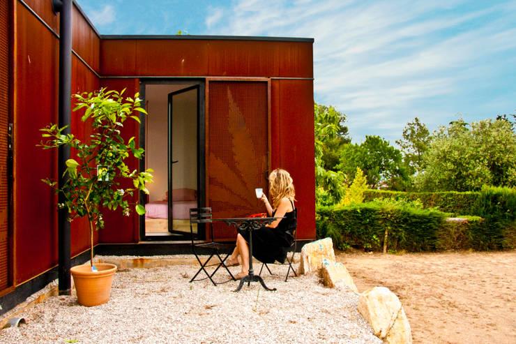 Fachada Vivienda Eco Menta: Casas ecológicas de estilo  por INFINISKI