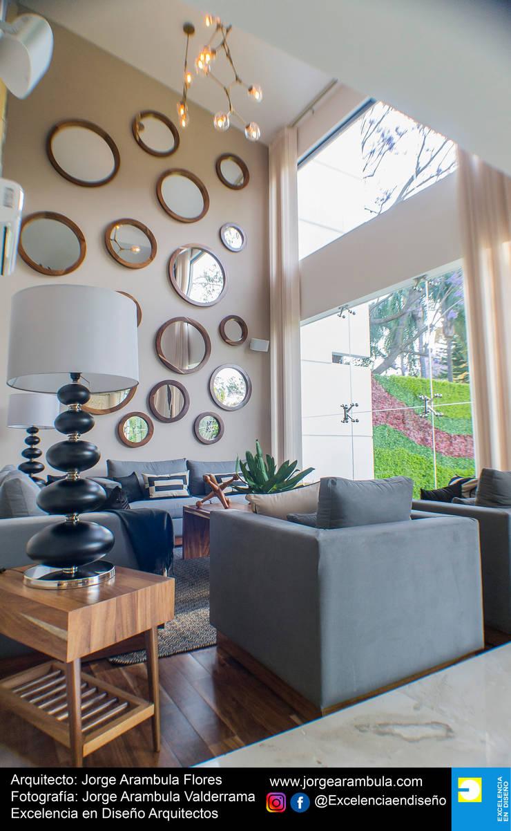 Casa Lagos 94: Salas de estilo  por Excelencia en Diseño,
