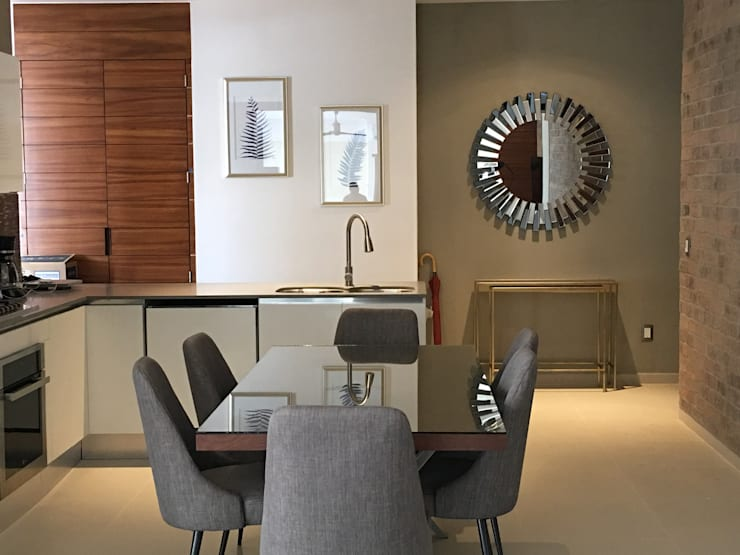 Modern dining room by DECO Designers Modern