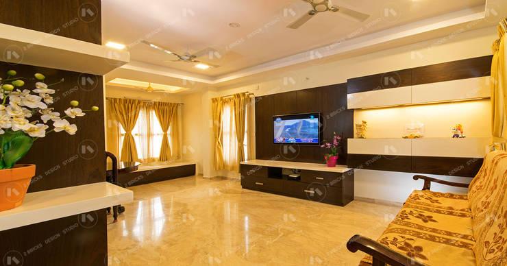 Living room by 2 Bricks Design Studio