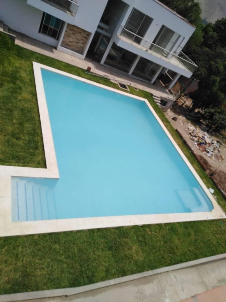 Piscina: Piscinas de jardín de estilo  por Pool Solei,