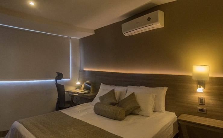 Remodelacion de habitación con iluminación y mobiliario : Hoteles de estilo  por CAMALEON DISEÑOS, Minimalista
