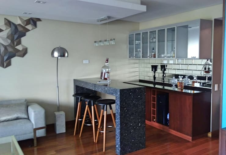 Bar con barra de granito: Salas/Recibidores de estilo  por Actio arquitectos