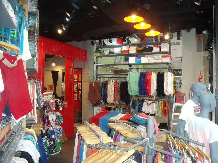 INTERIOR: Centros comerciales de estilo  por Proyecond Obras SAS, Industrial Mármol