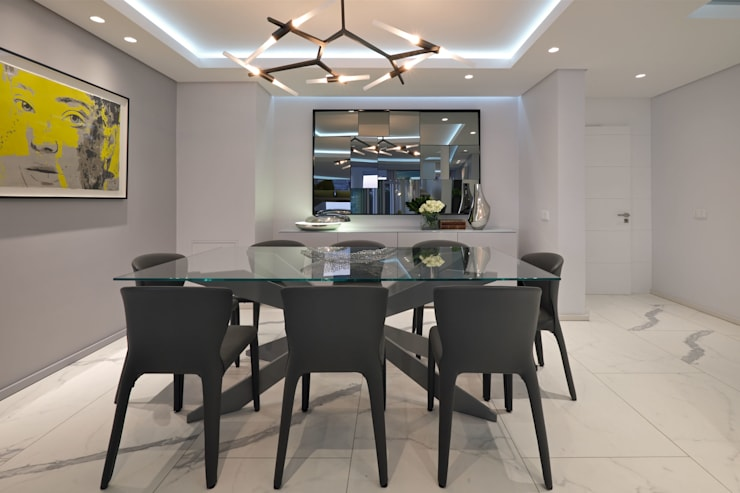 Dining room by KMMA architects, Modern