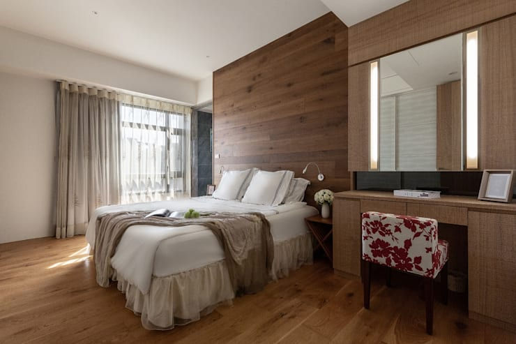 悠然寫意‧樂漫遊:  臥室 by 權相室內裝修設計有限公司