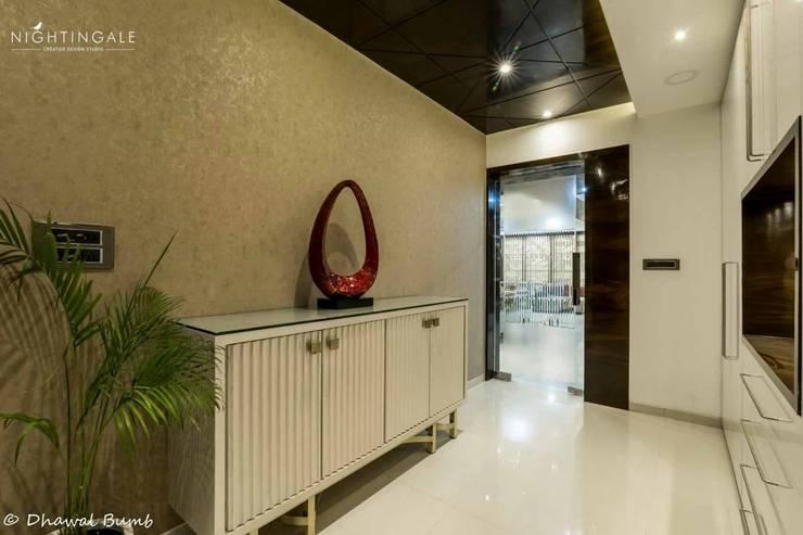 Storage smartly done in the hallway :  Corridor & hallway by Nightingale Creative Design Studio, Modern Engineered Wood Transparent