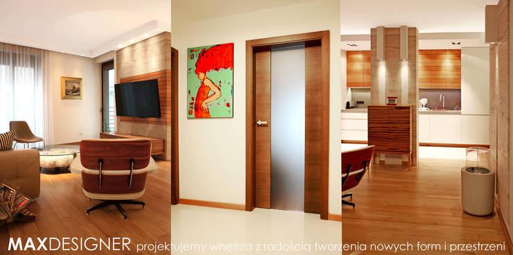 Salon z widokiem na kuchnię.: styl , w kategorii Salon zaprojektowany przez MAXDESIGNER