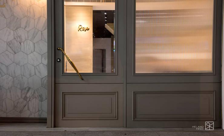 店面外觀(夜晚):  窗戶與門 by 禾廊室內設計,