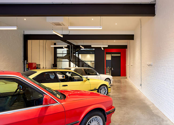 AutoHaus:  Garage/shed by KUBE Architecture, Modern