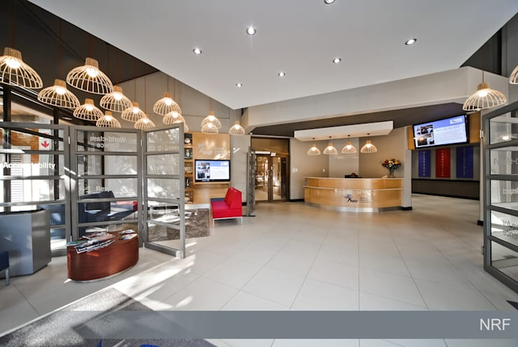 After: Modern reception area.:  Office buildings by Nuclei Lifestyle Design,