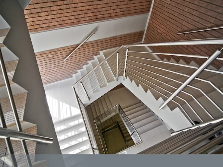 After. Enhanced and better-quality staircase.:  Office buildings by Nuclei Lifestyle Design,