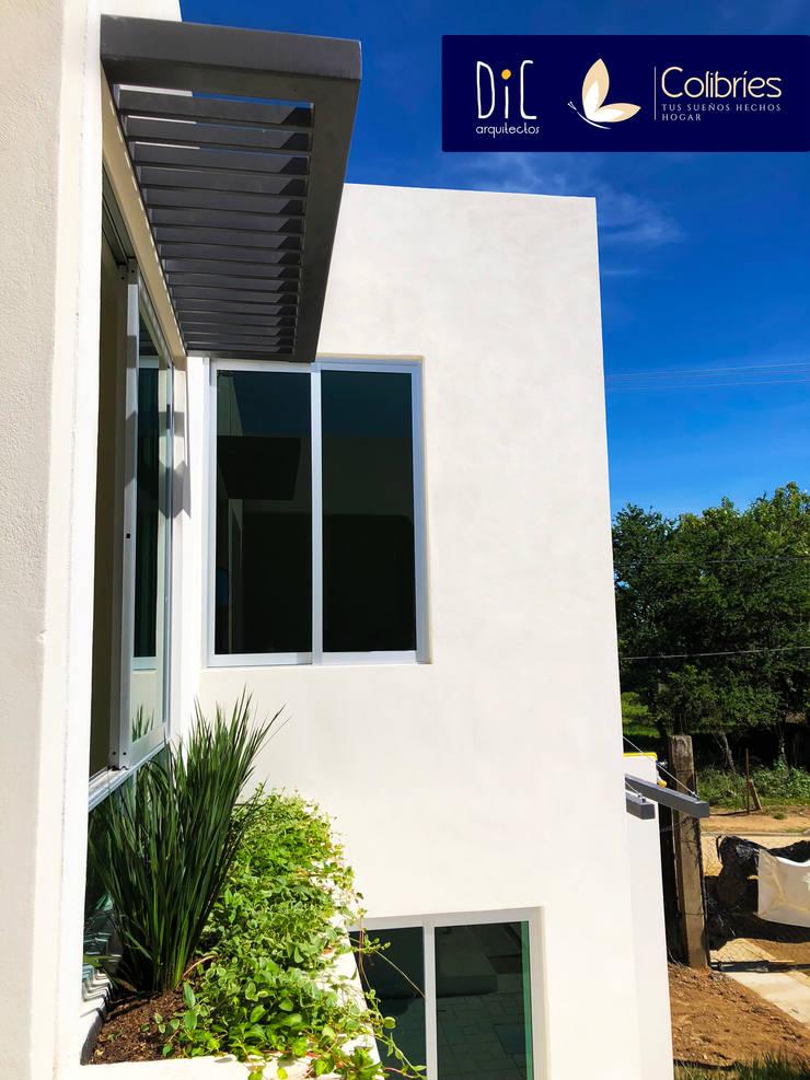Conjunto residencial de estilo  por Dic Arquitectos, Minimalista Concreto