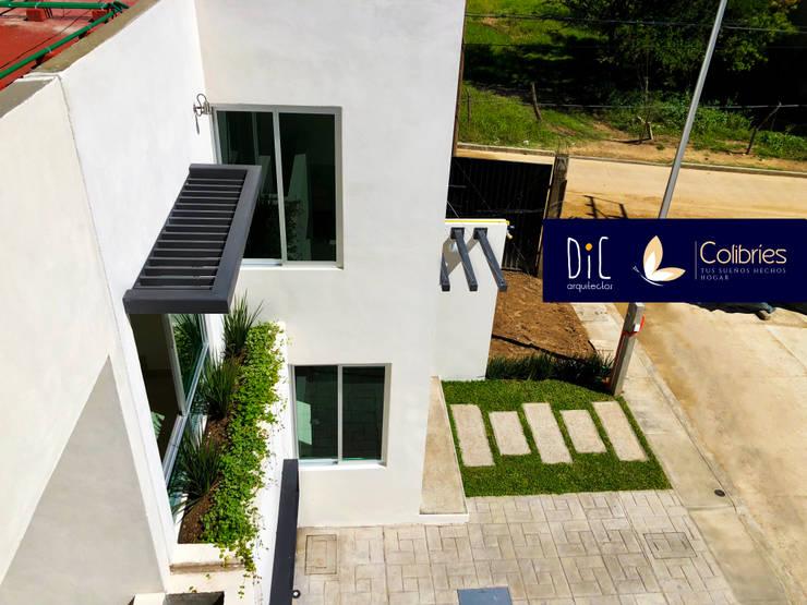 Conjunto residencial de estilo  por Dic Arquitectos, Minimalista Ladrillos