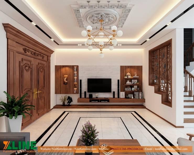 Thi công nội thất nhà ở gia đình chị Hoài :  Living room by NỘI THẤT XLINE