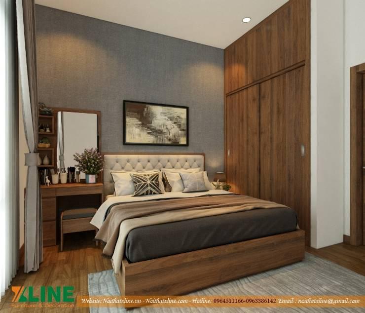 Thi công nội thất nhà ở gia đình chị Hoài :  Bedroom by NỘI THẤT XLINE