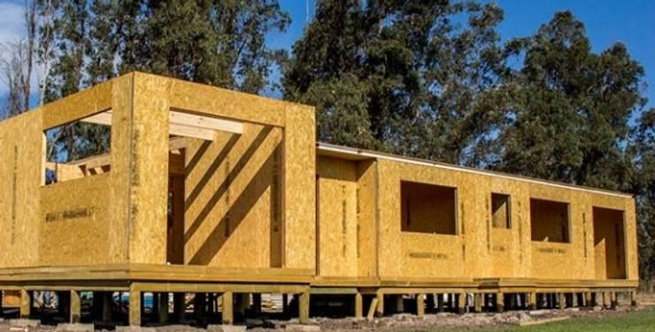 Vivienda en Curacavi de paneles sip LLAVE EN MANO 21 A 23 UF M2: Casas de campo de estilo  por SIPCORDILLERA
