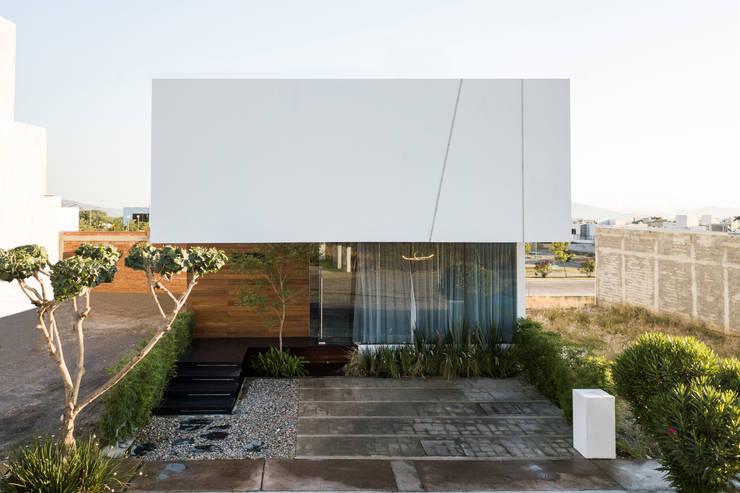Case in stile minimalista di 21arquitectos Minimalista
