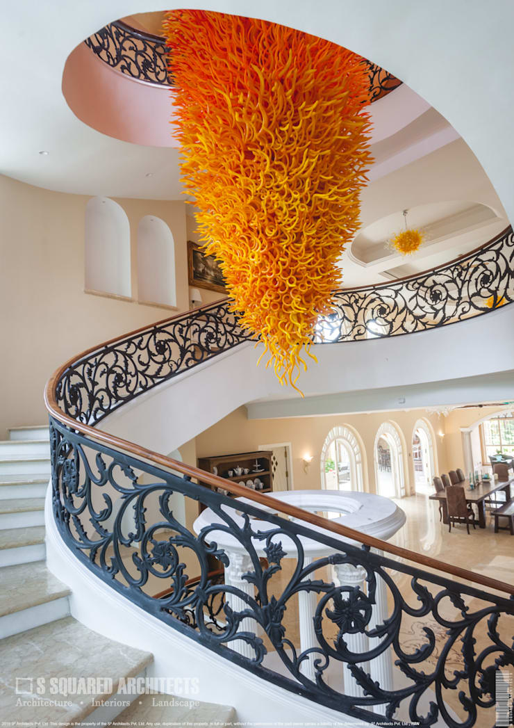 The 'Golden Hue' Residence :  Stairs by S Squared Architects Pvt Ltd.,Colonial Iron/Steel