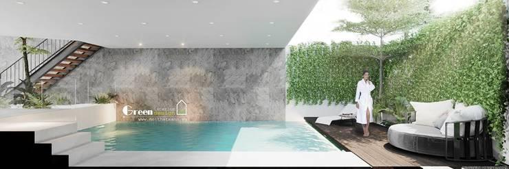 NHÀ PHỐ CAO BẰNG TRÀN NGẬP ÁNH SÁNG :  Hồ bơi by Green Interior