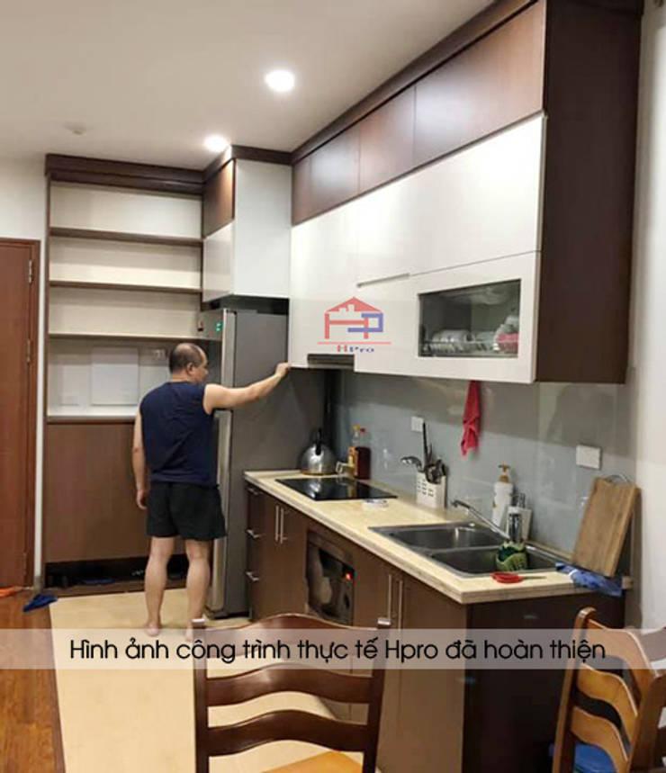Hình ảnh thực tế bộ tủ bếp laminate và tủ giày đa năng nhà anh Trung - Nguyễn Chánh:  Kitchen by Nội thất Hpro