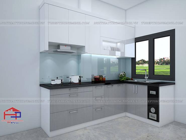 Hình ảnh thiết kế 3D mẫu tủ bếp acrylic nhà cô Tâm - Chùa Bộc:  Kitchen by Nội thất Hpro