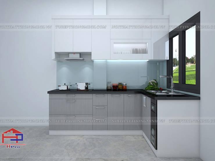 Hình ảnh thiết kế 3D mẫu tủ bếp acrylic chữ L nhà cô Tâm - Chùa Bộc:  Kitchen by Nội thất Hpro