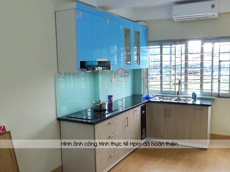 Hình ảnh thực tế bộ tủ bếp acrylic nhà cô Tâm - Chùa Bộc:  Kitchen by Nội thất Hpro