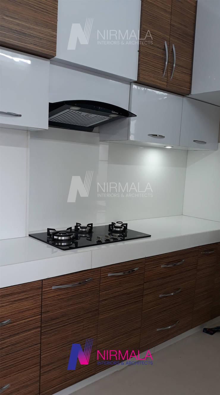 Interiors for 2 BHK at Vijaynagar Colony: modern  by Nirmala Architects & Interiors, Modern