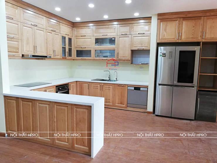 Hình ảnh thực tế bộ tủ bếp gỗ sồi nga nhà cô Thúy - Láng Hạ:  Kitchen by Nội thất Hpro,