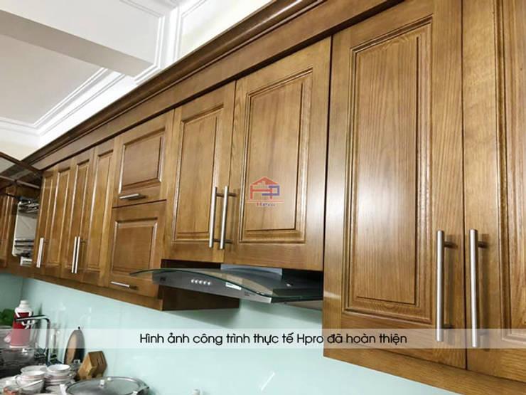 Hình ảnh thực tế bộ tủ bếp gỗ sồi mỹ tự nhiên hình chữ L nhà chị Thập - Hải Phòng:  Kitchen by Nội thất Hpro,