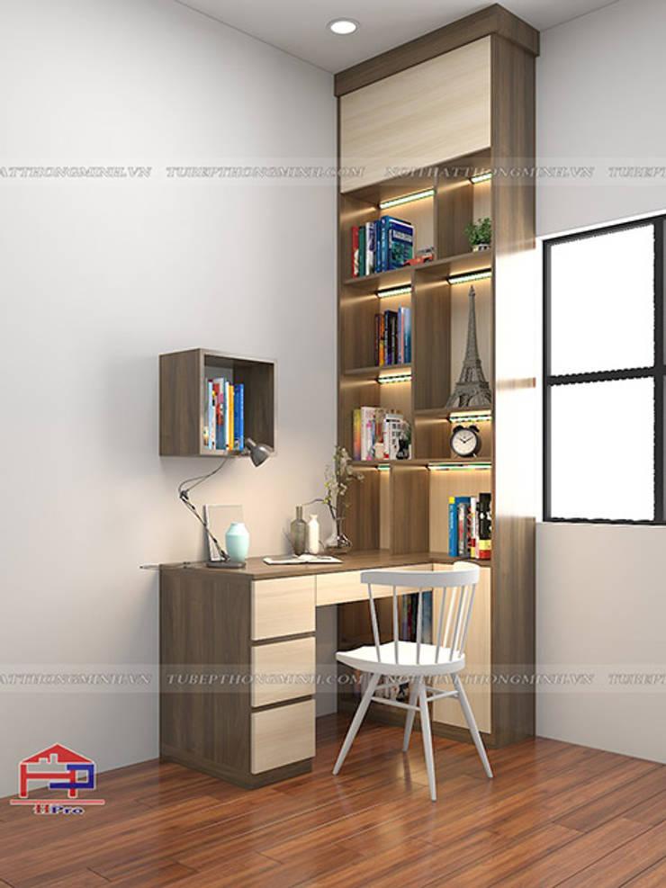 Hình ảnh thiết kế 3D bộ bàn học kèm giá sách gỗ melamine nhà chị Thoa - Tây Hồ:  Multimedia room by Nội thất Hpro,