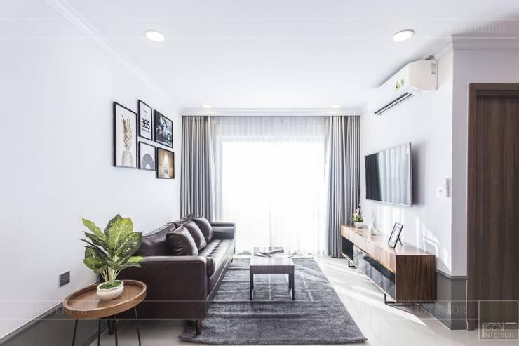 Thiết kế thi công nội thất chung cư 70m2 ấm cúng đáng mơ ước:  Phòng khách by ICON INTERIOR,