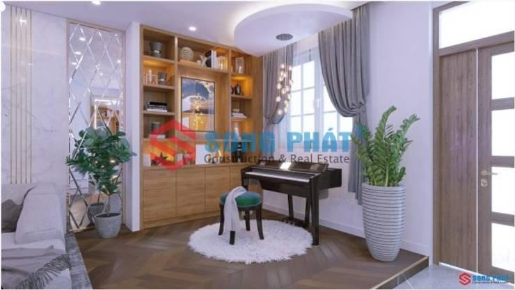 Thiết kế và thi công nội thất nhà phố 2 tầng 5x20m tại Bình Dương:  Living room by Công ty TNHH TK XD Song Phát,
