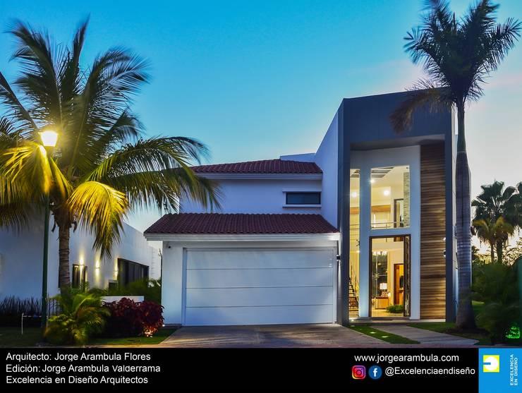Casa Vista Lagos: Casas unifamiliares de estilo  por Excelencia en Diseño,